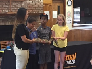 Photo of children holding an animal at library program