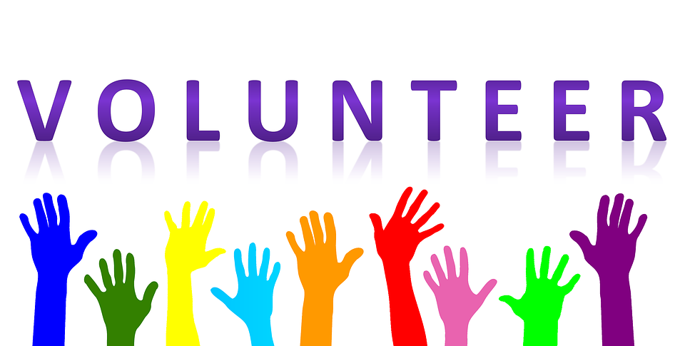 Header- Volunteer in large print, with rainbow colored hands in the air